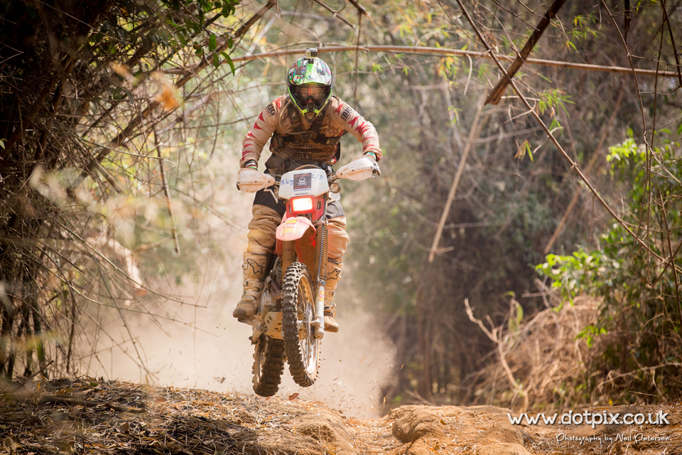 mud-splattered off-road biking in Cambodia